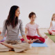 Woman teaching children (7-10) yoga